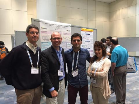 Professor Schirner's adviser attending the poster session