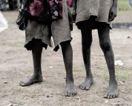 Two barefoot children wait during a food distribution in Buge village, Wolayita region in southern Ethiopia