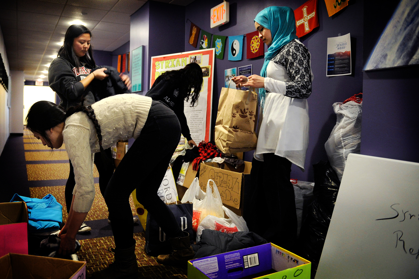 Feb. 3, 2017 - BOSTON, MA. - Karin Firoza, Assistant Director, Center for Spirituality, Dialogue, and Service, sorts through donations for the Syrian Refugee Relief Drive with Emily Luu, BHS'20, Maia Mellor, SSH'19, and Habiba Shaheed, S'20, at Northeastern University on Feb. 3, 2017. Donations can be made here: nudaysyria.net Photo by Matthew Modoono/Northeastern University