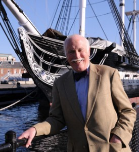 Distinguished Professor of History Bill Fowler in front of the USS Constitution.