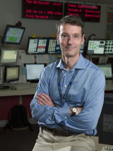 Professor Darien Wood in the D-Zero Experiment control room at the Fermi National Accelerator Laboratory. Photo credit Fermi National Accelerator Lab.
