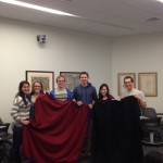 Scholars and their fleece blanket creation.
